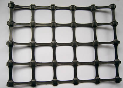 A piece of biaxial geogrid on a light gray background.