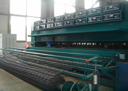There is a steel plastic geogrid production machine.