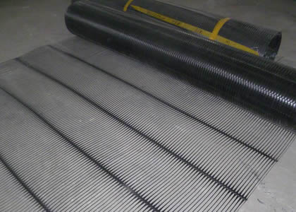A roll of uniaxial geogrid spreads on the ground.